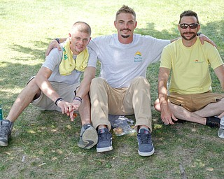 From left, Jay Weston, of Youngstown, Derek Damron, of Warren, and Casey Huffman, of Youngstown, all with New Day Recovery, smile for a photo at the Warren Walk Against Heroin at the Warren Amphitheater on Sunday. EMILY MATTHEWS | THE VINDICATOR