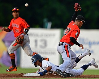 NILES, OHIO - JULY 30, 2019: Scrappers' Brayan Rocchio steals second base after Aberdeen's Joey Ortiz misplayed the ball in the third inning of their game, Tuesday night at Eastwood Field. DAVID DERMER | THE VINDICATOR
