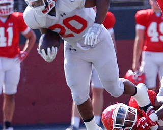 Christian Turner tries to run with the ball while Ray Anderson attempts to tackle him during their scrimmage Saturday morning at Stambaugh Stadium. EMILY MATTHEWS | THE VINDICATOR