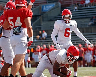 London Pearson dives into the end zone to score a touchdown during YSU's scrimmage Saturday morning at Stambaugh Stadium. EMILY MATTHEWS | THE VINDICATOR