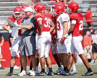 Head Coach Bo Pelini goes over plays with his team during YSU's scrimmage Saturday morning at Stambaugh Stadium. EMILY MATTHEWS | THE VINDICATOR