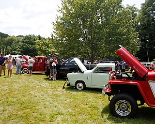 People look at antique cars at the 41st annual Cars in the Park car show in Boardman Park on Sunday afternoon. Proceeds from the car show will go to Harper, Foley, 4, who has Dravet Syndrome, a catastrophic form of epilepsy. EMILY MATTHEWS | THE VINDICATOR
