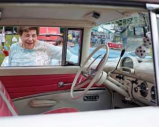 Mary Jo Herrholtz, of Niles, looks at the inside of a Ford Fairlane Crown Victoria at the 41st annual Cars in the Park car show in Boardman Park on Sunday afternoon. Proceeds from the car show will go to Harper, Foley, 4, who has Dravet Syndrome, a catastrophic form of epilepsy. EMILY MATTHEWS | THE VINDICATOR