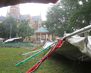 William D. Lewis the vindicator A fast moving storm Tuesday afternoon damaged tennts on Courthouse Squre in Warren.