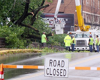 William D. Lewis the vindicator Warren City crews work at removing  downed tree on hte West Mrket St Bridge i in Warren after fast moving storm hit Tuesday 8-6-19 afternoon.