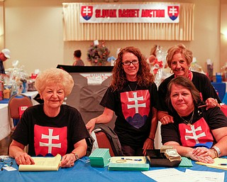 From left, JoAnn Maxgay, Denise Babik, Flora Schneider, and Monica Baytos, all of Youngstown, take a break from selling tickets for the basket auction in order to pose for a photo at the Slovak Fest at Byzantine Center at the Grove on Sunday afternoon. EMILY MATTHEWS | THE VINDICATOR