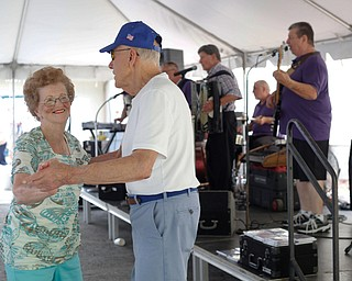 Pat Wagner and Joe Nemastil, both of Canton, dance while the Del Sinchak Band performs at the Slovak Fest at Byzantine Center at the Grove on Sunday afternoon. EMILY MATTHEWS | THE VINDICATOR
