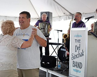 Rick Schen, of Canton, and Olga Spontak, of Zanesville, who recently celebrated her 90th birthday, dance while the Del Sinchak Band performs at the Slovak Fest at Byzantine Center at the Grove on Sunday afternoon. Schen and Spontak are friends who dance polka together. EMILY MATTHEWS | THE VINDICATOR
