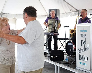 Olga Spontak, of Zanesville, who recently celebrated her 90th birthday, and Rick Schen, of Canton, dance while the Del Sinchak Band performs at the Slovak Fest at Byzantine Center at the Grove on Sunday afternoon. Spontak and Schen are friends who dance polka together. EMILY MATTHEWS | THE VINDICATOR