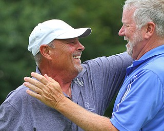 William D. Lewis The golfer vindicator Golfer Steve Sofocleous, left, gets congrats from scorekeeper Jim Phillips after sinking a long putt on #18 during Greatest Golfer Scramble at the Lake Club 8-12-19.
