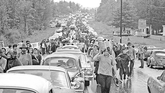 In this Aug. 16, 1969, file photo, hundreds of rock music fans jam a highway leading from Bethel, N.Y., as they try to leave the Woodstock Music and Art Festival. More than 400,000 people attended Woodstock, which was staged 80 miles northwest of New York City on a bucolic hillside owned by dairy farmer Max Yasgur.