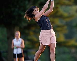 Felicia Drevna watches her drive during the long drive at Tippecanoe Country Club on Thursday night. EMILY MATTHEWS | THE VINDICATOR