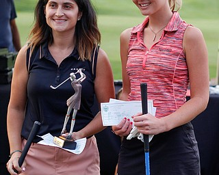 Felicia Drevna, left, and Jenna Jacobson pose after the long drive at Tippecanoe Country Club on Thursday night. Drevna came in first and Jacobson came in second. EMILY MATTHEWS | THE VINDICATOR