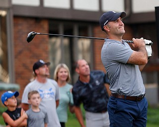 Patsy D'Altorio watches his drive during the long drive at Tippecanoe Country Club on Thursday night. EMILY MATTHEWS | THE VINDICATOR
