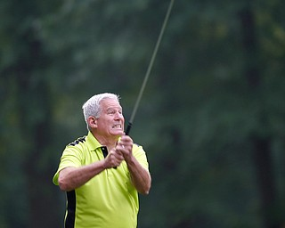 Frank Davidson reacts as he watches his drive during the Greatest Golfer of the Valley tournament at Mill Creek Golf Course on Friday. EMILY MATTHEWS | THE VINDICATOR