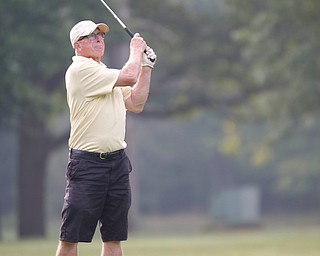 Rick Haldi watches his ball during the Greatest Golfer of the Valley tournament at Mill Creek Golf Course on Friday. EMILY MATTHEWS | THE VINDICATOR