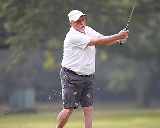Leonard Schneider hits the ball during the Greatest Golfer of the Valley tournament at Mill Creek Golf Course on Friday. EMILY MATTHEWS | THE VINDICATOR