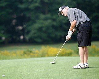 John Beard putts the ball during the Greatest Golfer of the Valley tournament at Mill Creek Golf Course on Friday. EMILY MATTHEWS | THE VINDICATOR