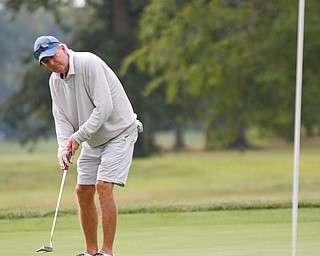 Dave Nagy putts the ball during the Greatest Golfer of the Valley tournament at Mill Creek Golf Course on Friday. EMILY MATTHEWS | THE VINDICATOR