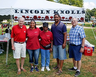 From left, Paul Dutton, with the Swanston Charitable Fund, Marguerite Douglas, the vice president of Lincoln Knolls, Ethel Hughey, the president of Lincoln Knolls, T.J. Rodgers, 2nd ward councilman, and Dennis Mangan, with Swanston Charitable Fund, pose for a photo at the improved Lincoln Knolls Community Park on Saturday. The park has a new playground and renovated basketball courts. EMILY MATTHEWS | THE VINDICATOR