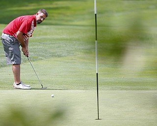 Eric Grunenwald putts the ball during the Farmers National Bank Greatest Golfer of the Valley tournament at Youngstown Country Club on Saturday. EMILY MATTHEWS | THE VINDICATOR