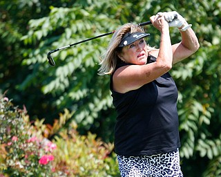 Pam Porter drives the ball during the final day of the Greatest Golfer tournament at the Lake Club on Sunday. EMILY MATTHEWS | THE VINDICATOR