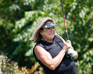 Pam Porter watches her drive during the final day of the Greatest Golfer tournament at the Lake Club on Sunday. EMILY MATTHEWS | THE VINDICATOR