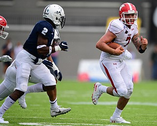 MONTGOMERY, ALABAMA - AUGUST 24, 2019: Youngstown State's Nathan Mays runs the ball away from Samford's Coutrell Plair during the first half of their game, Saturday afternoon. DAVID DERMER | THE VINDICATOR