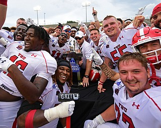 MONTGOMERY, ALABAMA - AUGUST 24, 2019: Members of the Youngstown State football team celebrate with the trophy after defeating Samford, Saturday afternoon. DAVID DERMER | THE VINDICATOR