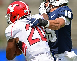 MONTGOMERY, ALABAMA - AUGUST 24, 2019: Youngstown State's Christian Turner stiff arms Samford's Ty Herring during the first half of their game, Saturday afternoon. DAVID DERMER | THE VINDICATOR