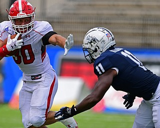MONTGOMERY, ALABAMA - AUGUST 24, 2019: Youngstown State's Joe Alessi fights off Samford's Aaron Atkinson during the first half of their game, Saturday afternoon. DAVID DERMER | THE VINDICATOR