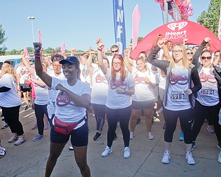 Shauntiaonia Johnson, front, a senior nursing student at YSU, dances with other YSU nursing students outside the Covelli Centre before the start of the 2019 Panerathon on Sunday morning. EMILY MATTHEWS | THE VINDICATOR