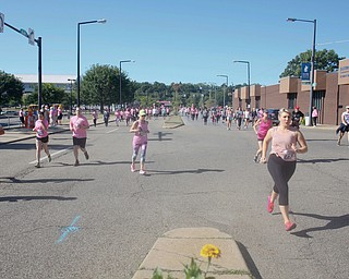 Runners and walkers make their way down Walnut Street during the 2019 Panerathon on Sunday morning. EMILY MATTHEWS | THE VINDICATOR