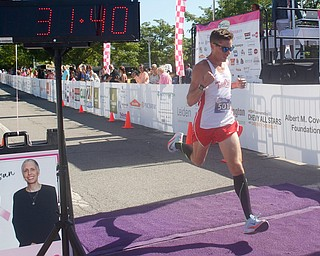 Andy Morgan, of Cortland, finishes the 10K in first place with a time of 31.40 during the 2019 Panerathon on Sunday morning. EMILY MATTHEWS | THE VINDICATOR