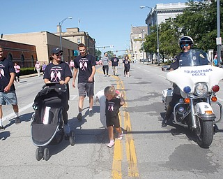 Youngstown Police Officer Bob Dimaiolo encourages his daughter Remy Dimaiolo, 3, to finish the two mile walk with, from left, Zach Stouffer, Jen Dimaiolo, and Ethan Overly, all of whom were walking in memory of Donna Yancsurak, during the 2019 Panerathon on Sunday morning. EMILY MATTHEWS | THE VINDICATOR