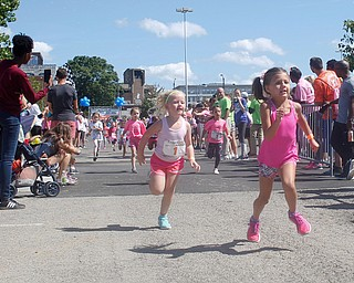 Carlena Savko, 5, of Columbiana, right, and Arilynn Yankley, 5, of Girard, run in the five year old girls division of the Kids Run during the 2019 Panerathon on Sunday morning. EMILY MATTHEWS | THE VINDICATOR
