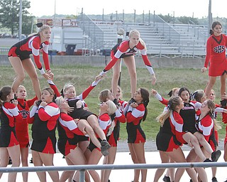 ROBERT K.YOSAY  | THE VINDICATOR..The 173rd version of the Canfield Fair opened Wednesday to mid 70 degrees, sun, and fries and sausage sandwiches...Cheerleaders from Struthers  High school part of the Cheerleading demonstration at the fair on Wednesday in the grandstand
