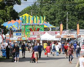 ROBERT K.YOSAY  | THE VINDICATOR..The 173rd version of the Canfield Fair opened Wednesday to mid 70 degrees, sun, and fries and sausage sandwiches..People Food Family and Friends.. the midway at the fair
