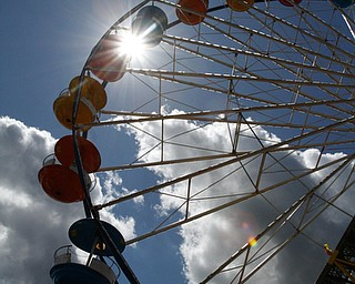 ROBERT K.YOSAY  | THE VINDICATOR..The 173rd version of the Canfield Fair opened Wednesday to mid 70 degrees, sun, and fries and sausage sandwiches...Rides sun and blue sky .....