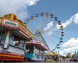 ROBERT K.YOSAY  | THE VINDICATOR..The 173rd version of the Canfield Fair opened Wednesday to mid 70 degrees, sun, and fries and sausage sandwiches...Food and rides and blue sky