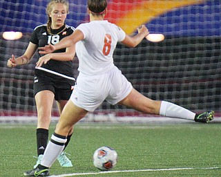 William D. Lewis the vindicator  Howland's Olivia Myers(8) kicks around Mooney's Keelee Torma(18) during 8-28-19 action at YSU.