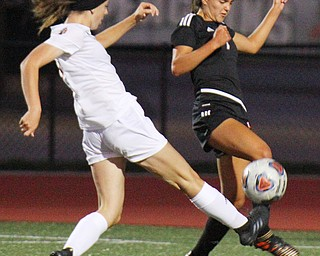 William D. Lewis The Vindicaor  Howland's Rylie Daniluk, 1, left, and Mooney's Gia Diorio(7) go for the ball during 8-28-19 action at YSU.