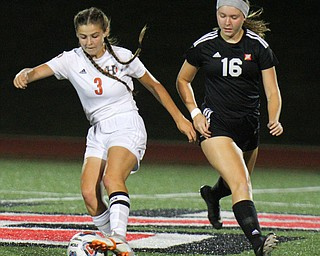 William D. Lewis The Vindicator Howland's Ashley Chamber's(3) moves the ball past Mooney's Ava Szaly(16) during 8-28-19 action at YSU.