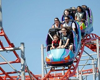 People ride the roller coaster at the Canfield Fair on Thursday. EMILY MATTHEWS | THE VINDICATOR