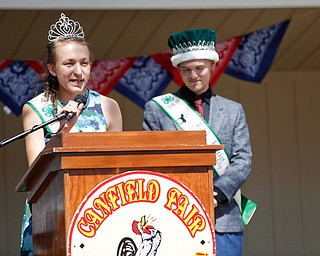 Callia Barwick, left, last year's 4-H queen, and Matthew Fetty, last year's 4-H king, speak before the crowning of this year's king and queen during the Mahoning County Junior Fair Youth Day Ceremony on Thursday. EMILY MATTHEWS | THE VINDICATOR
