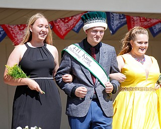 Natalia Kresic, left, of Lordstown, and Cheyenne Heffner, right, of Springfield, are escorted by last year's 4-H king Matthew Fetty before the crowning of this year's king and queen during the Mahoning County Junior Fair Youth Day Ceremony on Thursday. Kresic was crowned this year's queen. EMILY MATTHEWS | THE VINDICATOR