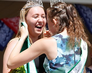 Callia Barwick, right, last year's 4-H queen, crowns Natalia Kresic this year's 4-H queen during the Mahoning County Junior Fair Youth Day Ceremony on Thursday. EMILY MATTHEWS | THE VINDICATOR