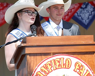 Brittany Siembieda, left, and James Moore, last year's Outstanding Youth, speak before crowning this year's Outstanding Youth during the Mahoning County Junior Fair Youth Day Ceremony on Thursday. EMILY MATTHEWS | THE VINDICATOR