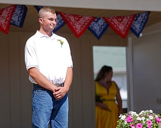 Thomas Kemp, of West Branch, stands on stage before the crowning this year's Outstanding Youth during the Mahoning County Junior Fair Youth Day Ceremony on Thursday. Kemp was crowned this year's male Outstanding Youth. EMILY MATTHEWS | THE VINDICATOR
