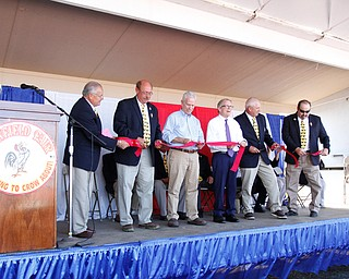 ROBERT K.YOSAY  | THE VINDICATOR..The 173rd version of the Canfield Fair official ribbon cutting as Fred Moran 84 jumped from the plane to help publicize Veterans Jobs..George Roman- David Dickey  rep Bill Johnson gov Mike DeWine- Ward Campbell and Frank Paden   all with the board of directors